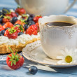 Close-up on coffee and tart with strawberries and blueberries — Stock Photo #50136387