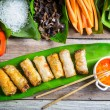 Fried spring rolls surrounded by ingredients — Stock Photo #50136731