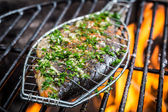 Grilled fish with spices on fire — Stock Photo