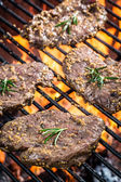 Fresh cured steak on the grill with fire — Stock Photo
