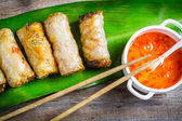 Close-up on spring rolls and sweet and sour sauce — Stock Photo