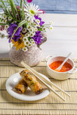 Spring rolls served with chili sauce — Stock Photo