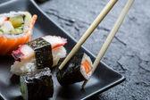 Sushi eaten with chopsticks — Stock Photo