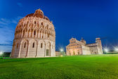 Ancient monuments in Pisa at sunset — Stock Photo
