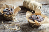 Chocolate muffins wrapping with string — Stock Photo