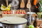 Preparing for pancakes with fruit and chocolate — Stock Photo