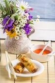 Spring rolls with sweet and sour sauce — Stock Photo
