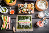 Table with ingredients for sushi — Stock Photo