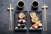 Sushi served with soya sauce for two people — Stock Photo