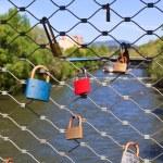 Love locks on a bridge — Stock Photo #13527666