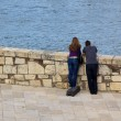 Lovers looking into the water — Stock Photo