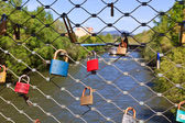 Love locks on a bridge — Foto Stock