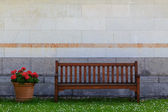 A bench in front of a wall — Stock Photo