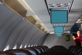 Plane cabin with screens — Stock Photo
