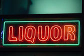 Liquor neon sign — Stock Photo