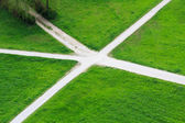 Crass grossroads in the middle of grassland — Stock Photo