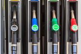 Nozzles on a gas station — Stock Photo