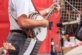 člověk hraje banjo — Stock fotografie