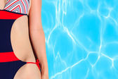 Woman detail next to pool water — Stock Photo