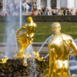 Gold statues and fountains in Peterhof castle — Stock Photo #37771739