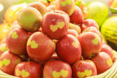 Apples with carved hearts — Stock Photo