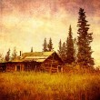 Old Alaskan cabin with vintage texture - Stock Photo