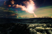 Surrealistic scene with a flash of light over the sea — Stock Photo