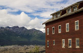 Old building with mountains. — Stock Photo