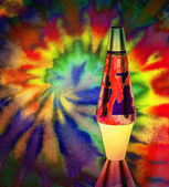 Lava lamp with colorful background — Stock Photo