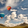 Hot air balloons over mountains — Stock Photo #41964065