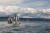 Storm clouds with sail boat — Stockfoto