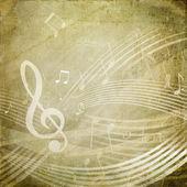 Treble clef on grunge background — Stock Photo