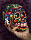 Colorful Beaded Skull on Hand — Stock Photo