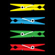 Yellow, blue, red and green clothes peg - Stock Photo
