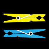 Żółty i niebieski odzież kołki — Zdjęcie stockowe