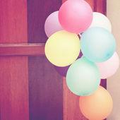 Balloons hanging on door — Stock Photo