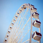 Ferris wheel with clear blue sky, retro filter effect — Stock Photo