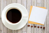 Blank paper and coffee cup — Stock Photo