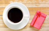 Coffee with present box — Stock Photo