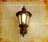 Lamp on brick wall — Stock Photo