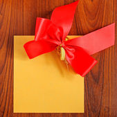 Notepaper with bow — Stock Photo