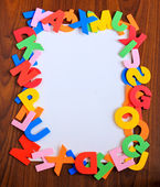 Alphabet frame and paper — Stock Photo