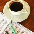 Stock Photo: Coffee on music note