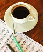 Coffee on music note — Stock Photo