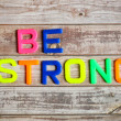 Be strong in plastic letterpress — Stock Photo
