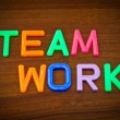 Team work in toy letters — Stock Photo