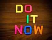 Do it now in toy letters — Stock Photo
