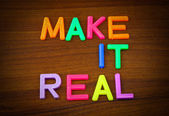Make it real in toy letters — Stock Photo