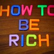 How to be rich in colorful letters — Stock Photo