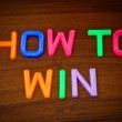 How to win in colorful letters — Stock Photo